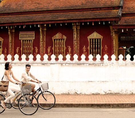 cycling to temples in luang parabang