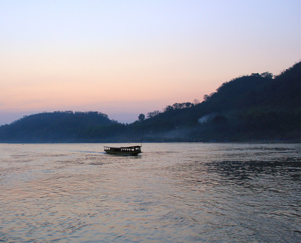take a river cruise through luang prabang
